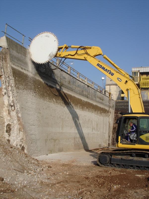 10 foot saw cutting canal wall on Komatsu Excavator