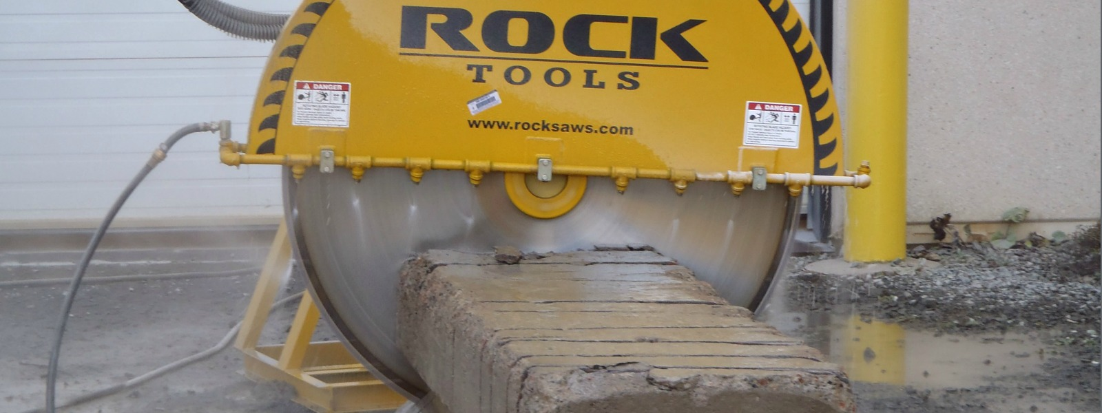 Concrete saw cutting concrete blocks
