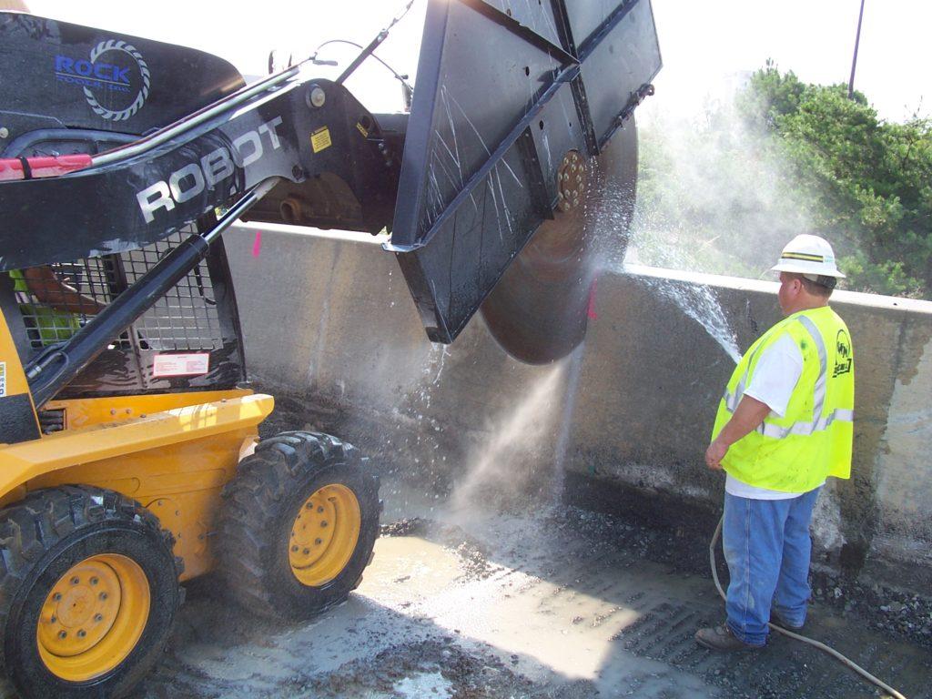 Skid steer demolition saw attachment on Robot Skid Steer