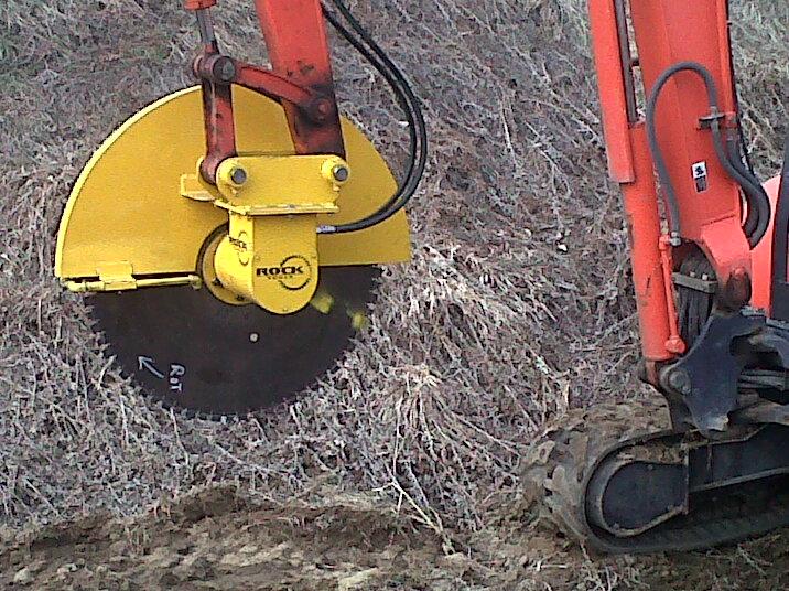 Concrete scabble saw attachment on mini excavator